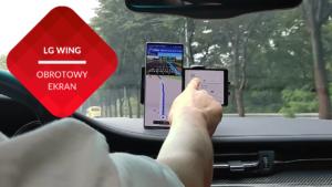 przenosnepl ręka w samochodzie dotyka wyświetlacza LG wing