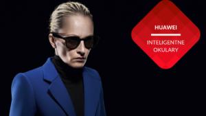 przenosnepl_kobieta blondynka uczesana do tyłu w niebieskim żakiecie ma na nosie czarne okulary przeciwsłoneczne