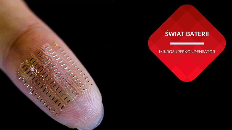 przenosnepl_palec czlowieka zblizenie z mikrokondensatorami na przezroczystej plytce
